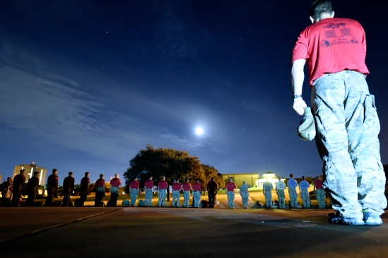 Special Tactics Airmen pledge allegiance to the U.S. flag before the start of the 2015 Special Tactics Memorial Ruck March at Joint Base San Antonio-Lackland Medina Annex, Oct.4, 2015. The march covers over 812 miles, ending at Hurlburt Field, Fla., in memory of fallen comrades since Sept. 11, 2001. Each Airman carries a 50 pound ruck to bring awareness to the service and sacrifice of Special Tactics members. (U.S. Air Force photo by Senior Keith James/Released)